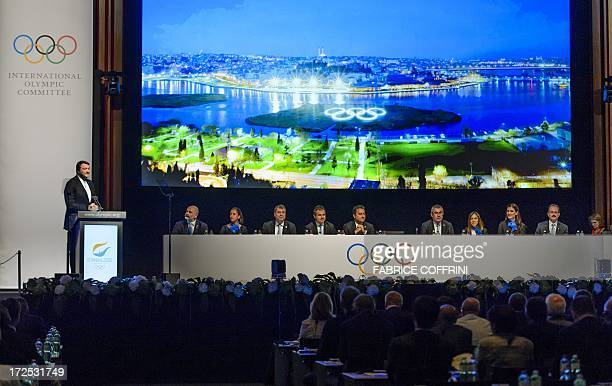 Members of the delegation of Istanbul 2020 candidate city listen to their chairman Hasan Arat on July 3 2013 in Lausanne during the bid presentation...
