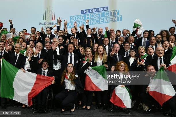 Members of the delegation of Milan/Cortina d'Ampezzo 2026 Winter Olympics candidate city react after the city was elected to host the 2026 Olympic...