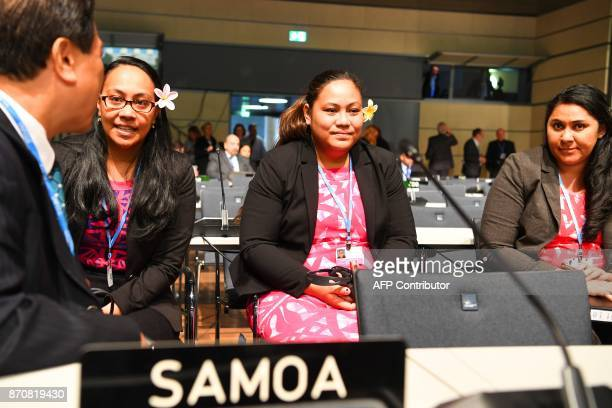 Members of the delegation of Samoa sit in the plenary room at the opening session of the COP23 United Nations Climate Change Conference on November...