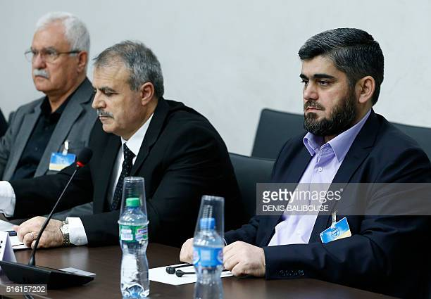 Members of the delegation of the High Negotiations Committee Mohamed Alloush Asaad Al-Zoubi and George Sabra wait prior to a meeting with U.N....