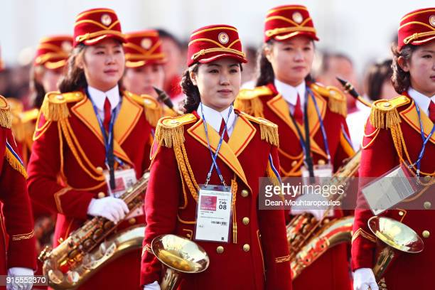 Members of the Democratic People's Republic of Korea band look on during their welcome ceremony ahead of the PyeongChang 2018 Winter Olympic Games at...