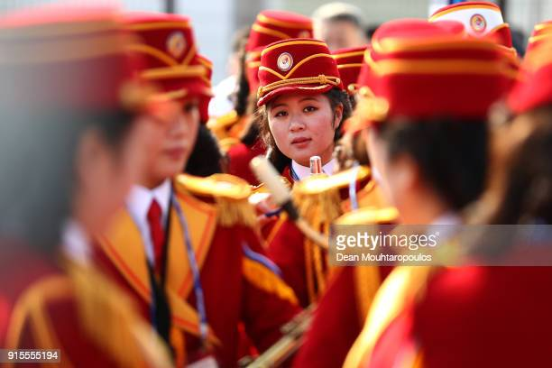 Members of the Democratic People's Republic of Korea delegation band look on during their welcome ceremony ahead of the PyeongChang 2018 Winter...