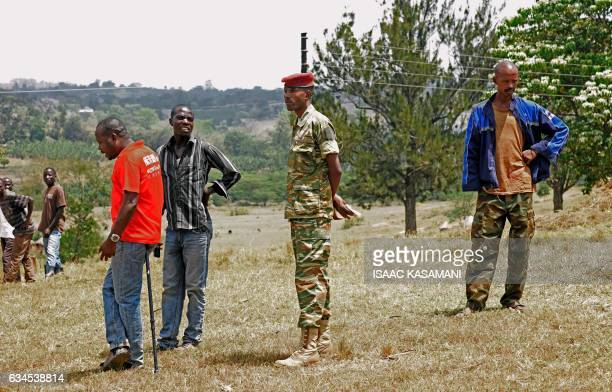 Members of the Democratic Republic of Congo rebel group M23 wait at the Bihanga military base in Uganda about 400 kilometres west of the capital...