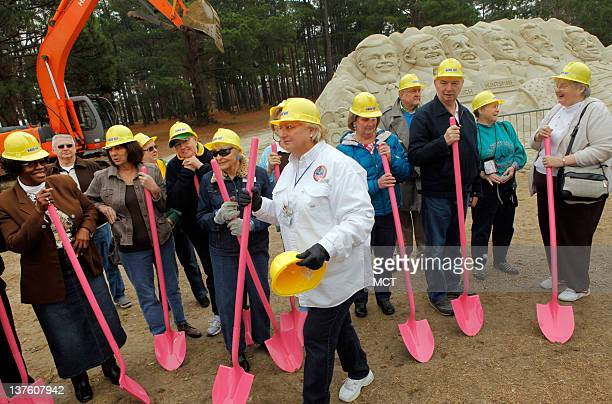 Members of the Democratic Women of Horry County get ready as they secured the rights to demolish the Republican 2012 Primary Debate Sand Sculpture...