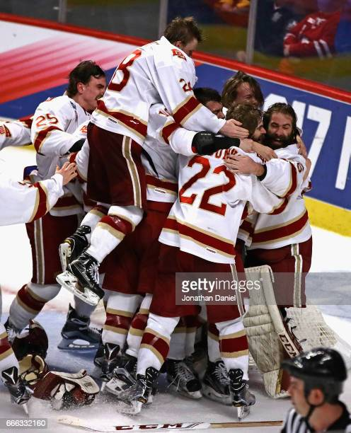 Members of the Denver Pioneers mob goaltender Tanner Jaillet after w in over the Minnesota-Duluth Bulldogs during the 2017 NCAA Division I Men's Ice...
