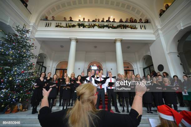 Members of the department's staff choir perfom during an annual lunchtime recital of Christmas Carols at Government Buildings On Monday 18 December...