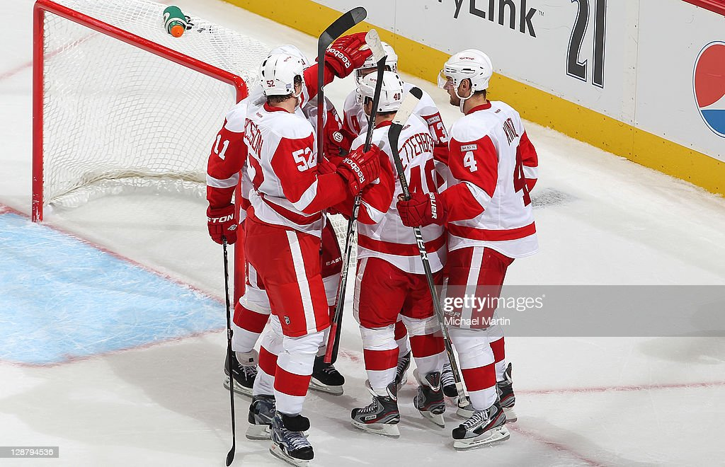 Members of the Detroit Red Wings celebrate a goal against the Colorado Avalanche at the Pepsi Center on October 8, 2011 in Denver, Colorado. Detroit beat Colorado 3-0.