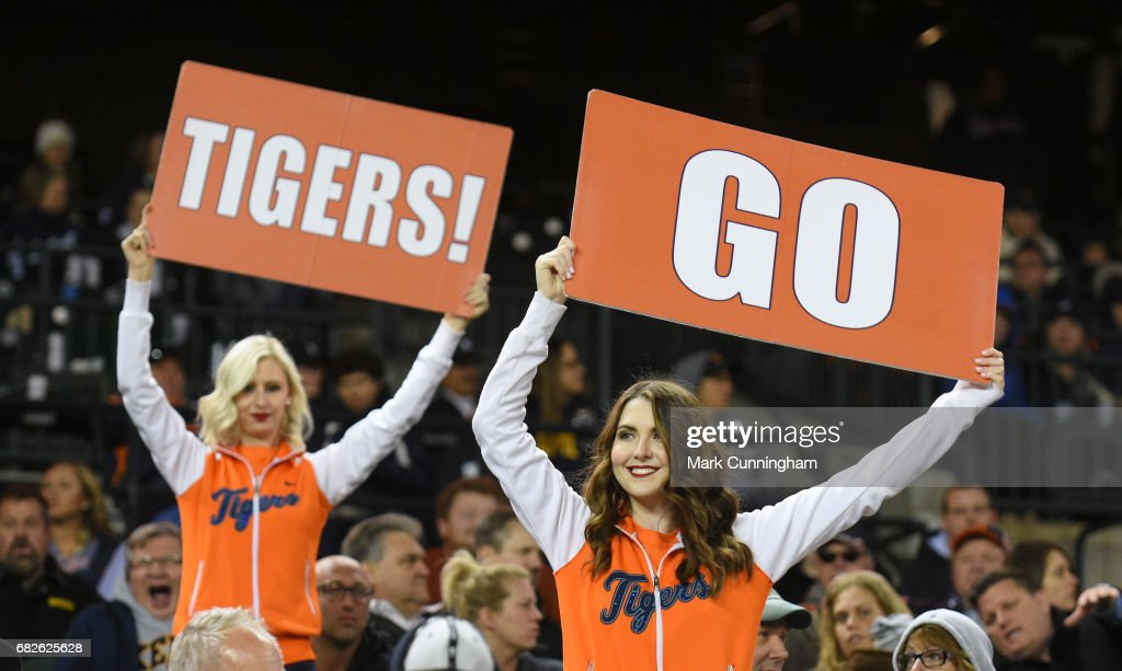 Members of the Detroit Tigers Energy Squad hold up signs to fire up the crowd during the game against the Cleveland Indians at Comerica Park on May 3, 2017 in Detroit, Michigan. The Indians defeated the Tigers 3-2.