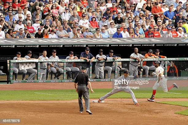 Members of the Detroit Tigers watch centerfielder Michael Bourn of the Cleveland Indians get tagged out at first base by firstbaseman Victor Martinez...