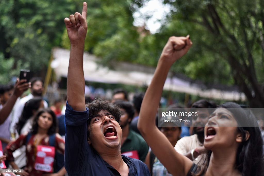 Members of the different Students' Unions shout slogans in support of their candidates during Jawaharlal Nehru University (JNU) Students Union Elections, at the JNU campus, on September 14, 2018 in New Delhi, India. The Left-backed All India Students' Association, Students Federation of India, Democratic Students Federation and All India Students Federation have come together to form the United-Left alliance, which has fielded N Sai Balaji as its presidential candidate. The NSUI has fielded Vikas Yadav for the president's post. The RSS-affiliated Akhil Bharatiya Vidyarthi Parishad (ABVP) has fielded Lalit Pandey for the president's post.