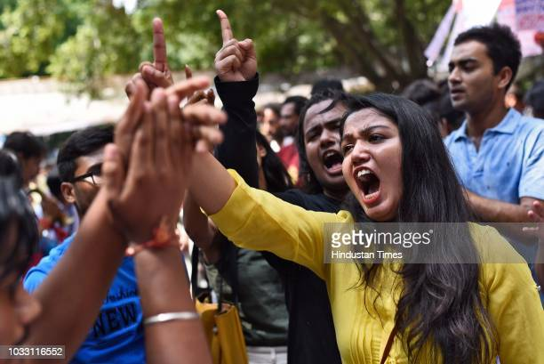 Members of the different Students' Unions shout slogans in support of their candidates during Jawaharlal Nehru University Students Union Elections at...