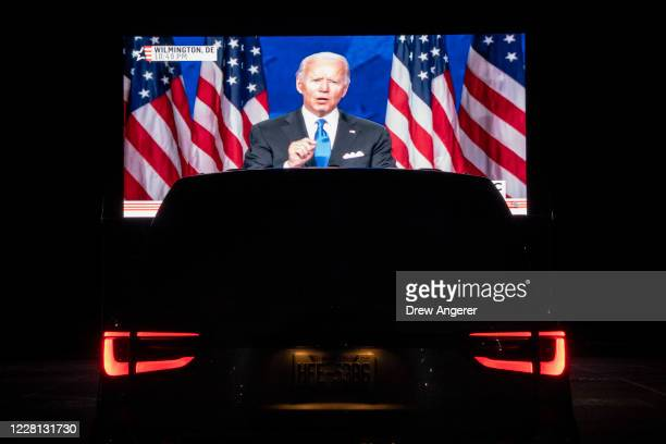 Members of the District of Columbia Democratic Party attend a drive-in watch party in the parking lot of the Robert F. Kennedy Memorial Stadium to...