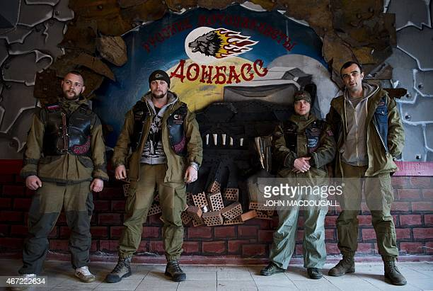 Members of the Donbass Night Wolves motorbike club including local president Vitali Prokuror pose at the club's base in Lugansk on March 17 2015...
