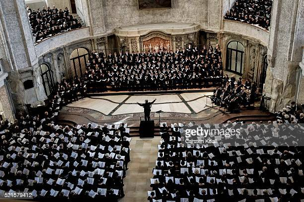 Members of the Dresdner Kreuzchor boy's choir take part in an evening concert together with other choirs at the Kreuzkirche Church on April 16 2016...
