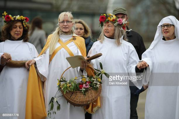 Members of the Druid Order take part in a celebration of the Spring Equinox during a ceremony at Tower Hill on March 20 2017 in London England The...