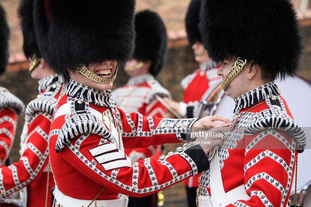 Members of the Drum Corp of the Coldstream Guards make last minute adjustments before they take part in the annual Major General's Inspection at Victoria barracks on February 21, 2018 in Windsor, England. The inspection gives the Major General his first chance to check the presentation, uniforms and drill of the battalion, ahead of it's involvement in the Trooping the Colour Parade in London.