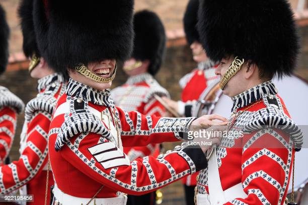 Members of the Drum Corp of the Coldstream Guards make last minute adjustments before they take part in the annual Major General's Inspection at...