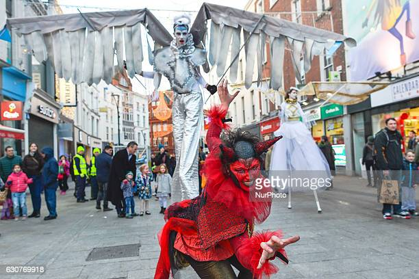 Members of the Dublin Circus Project dressed as angels and devils perform on Dublin's Grafton Street on the New Year Day as a part of New Year's...
