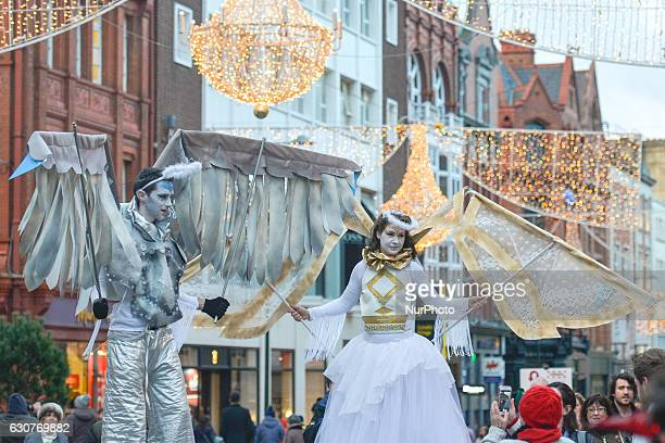 Members of the Dublin Circus Project dressed as angels perform on Dublin's Grafton Street on the New Year Day as a part of New Year's Festival on...