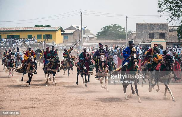 Members of the Durbar procession race the final stretch to the Emir's palace in Kano northern Nigeria on July 6 2016 Kano is Nigeria's largest Muslim...