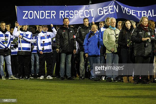 Members of the Dutch football club SC Buitenboys take part in a silent march to pay their respects to their late linesman Richard Nieuwenhuizen in...
