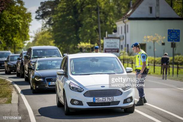 Members of the Dutch Military police carry out checks at the border with Germany in Vlodrop The Netherlands on April 25 as Germans want to go to The...