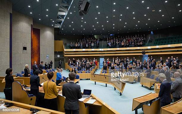 Members of the Dutch parliament in the Senate observe a minute of silence for the victims of the Berlin Christmas market attack in The Hague on...