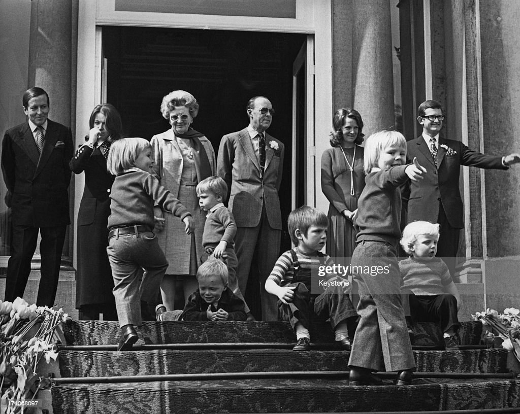 Members of the Dutch royal family on the steps of the Soestdijk Palace, during celebrations for the birthday of Queen Juliana of the Netherlands (1909 - 2004, centre, left), Utrecht, Netherlands, 30th April 1972. The adults are (left to right): Prince Claus, Princess Beatrix, Queen Juliana, Prince Bernhard, Princess Margriet and Pieter van Vollenhoven.