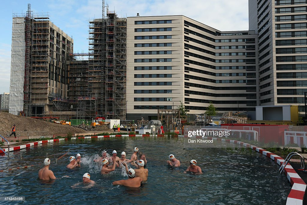 Members of the East German Ladies' swimming team gather in the new 'King's Cross Pond Club' outdoor swimming pool on May 22, 2015 in London, England. The 40 metre pool is purified using submerged plants to filter the water and is surrounded by flowers and plants. It is open to members of the public Monday and Friday between 6am and dusk.