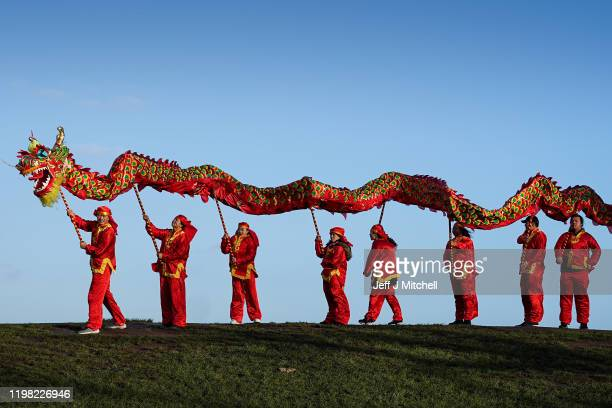 Members of the Edinburgh Chinese community launch the city's Chinese New Year Festival with a dragon dance on Calton Hill on January 8, 2020 in...