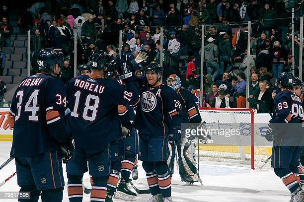 Members of the Edmonton Oilers celebrate a 50 win over the Calgary Flames at Rexall Place on February 4 2008 in Edmonton Alberta Canada