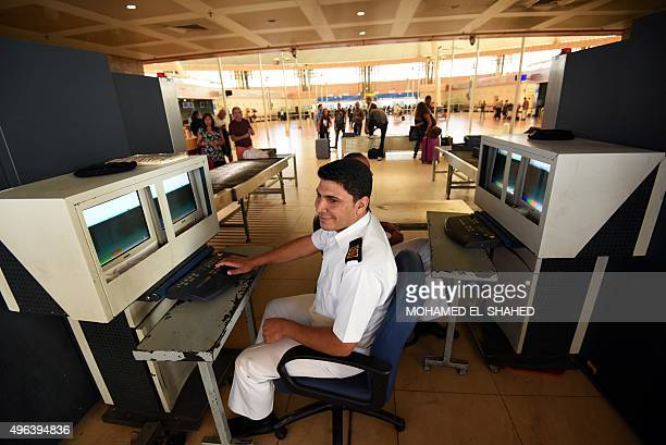 Members of the Egyptian airport security check the screens of xray machines at the airport in Egypt's Red Sea resort of Sharm ElSheikh on November 9...