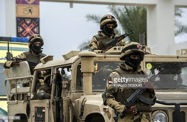 Members of the Egyptian army stand guard outside the venue of a conference for defence ministers and officials of the 27 members of CEN-SAD in...