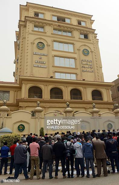 Members of the Egyptian Muslim brotherhood pray in front the party's headquarters in Cairo on March 22, 2013. A group of men stormed a Muslim...