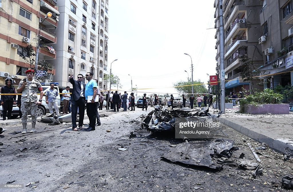 Members of the Egyptian security services inspect the scene of a bombing targeting the convoy of the Egyptian Prosecutor General Hisham Barakat, in a northern suburb of Heliopolis, Cairo, Egypt, 29 June 2015 According to the source, the prosecutor-general sustained moderate injuries and was taken to hospital.