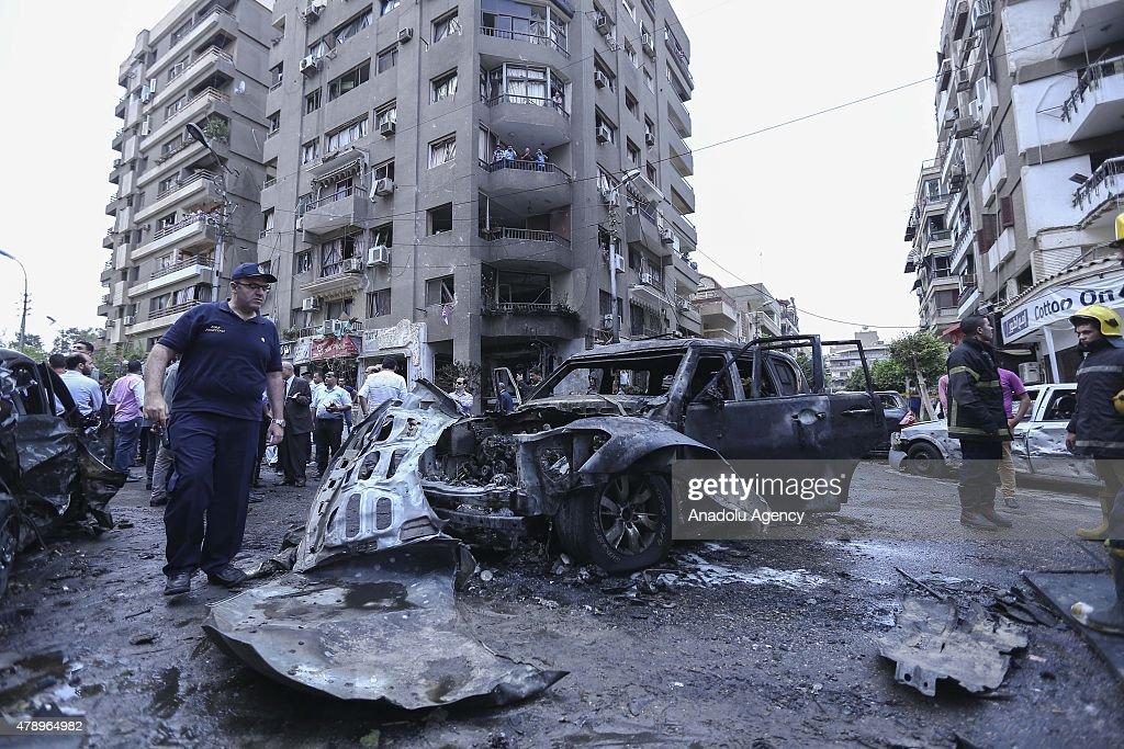 Members of the Egyptian security services inspect the scene of a bombing targeting the convoy of the Egyptian Prosecutor General Hisham Barakat, in a northern suburb of Heliopolis, Cairo, Egypt, on 29 June 2015. According to the source, the prosecutor-general sustained moderate injuries and was taken to hospital.