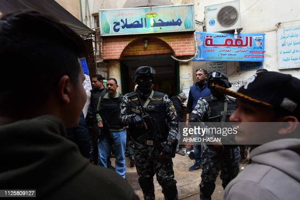 Members of the Egyptian special forces stand guard outside a mosque during the funeral of policeman Mahmud Abu elYzied one of three policemen killed...