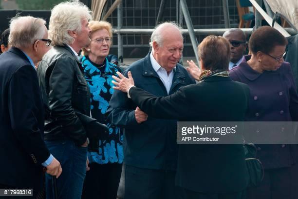 Members of The Elders group former president of Finland Martti Ahtisaari The Elders' Advisory Council member Sir Richard Branson former Irish...
