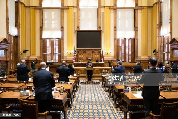 Members of the Electoral College applaud after casting their vote at the Georgia State Capitol in Atlanta, Georgia, U.S., on Monday, Dec. 14, 2020....