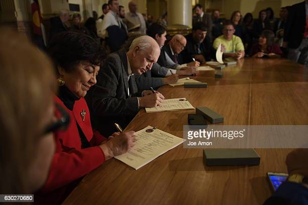 Members of the Electoral College sign their Certificate of Vote after voting for the President and the vice president of the United States at the...