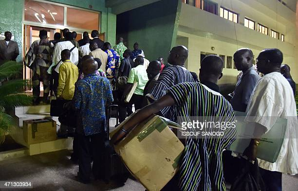 Members of the electoral committee observers and representatives of the candidates arrive at the headquarters of the Independent National Electoral...