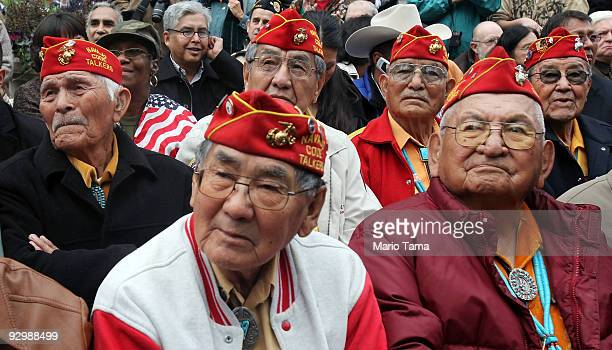 Members of the elite Navajo Code Talkers the famed US Marine unit who delivered unbreakable codes during World War II battles against the Japanese...