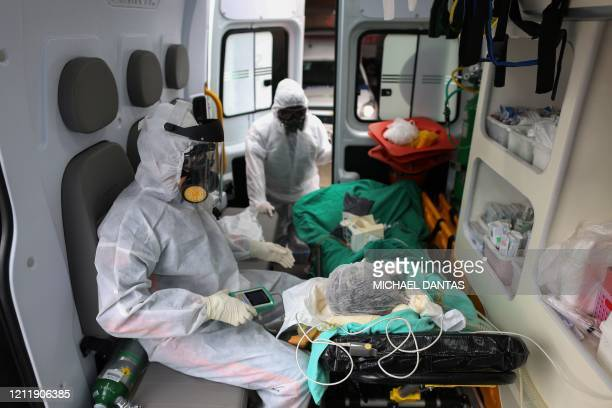 Members of the emergency medical service SAMU arrive with a patient suspected of being infected with the novel coronavirus COVID19 at the hospital in...