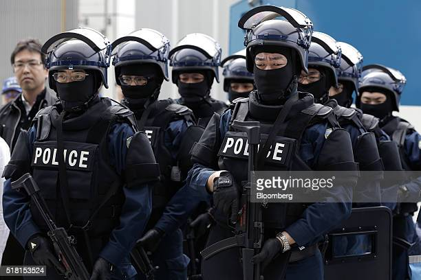 Members of the Emergency Response Team of Japan's Metropolitan Police Department line up after a drill for the simulation of a bus hijacking and...
