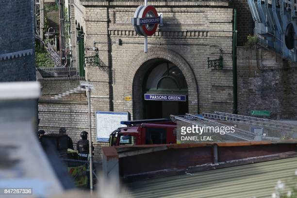Members of the emergency services and armed police officers work outside Parsons Green underground tube station in west London on September 15...