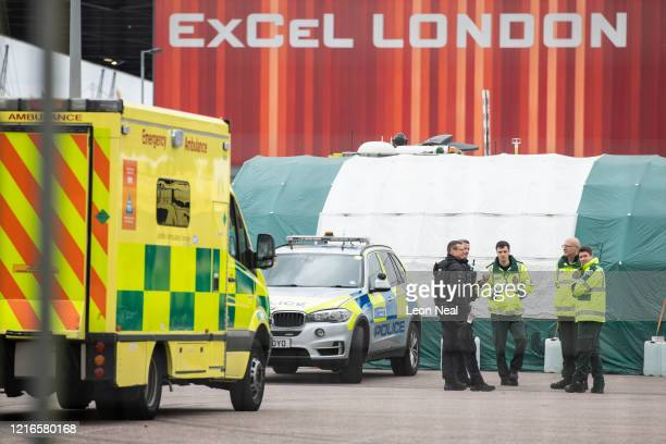 Members of the emergency services are seen in the ambulance parking area ahead of the official opening of the NHS Nightingale Hospital at ExCel on...