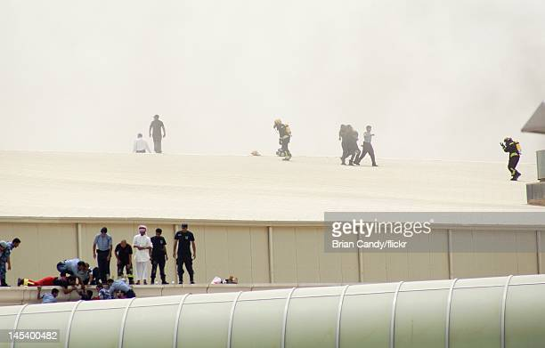 Members of the emergency services attempt to rescue victims from the roof of the Villaggio mall on May 28, 2012 in Doha, Qatar. A fire started at the...