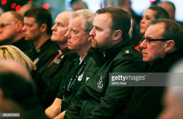 Members of the emergency services attend a service of remembrance at St George's Tron Church of Scotland in Glasgow following yesterday's bin lorry...