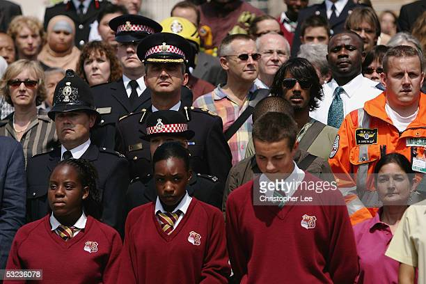 Members of the Emergency Services, Children, Celebrities, Members of Parliament and people of mixed faith and relegion stand for a two minute silence...