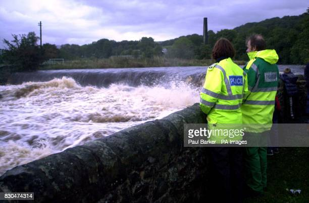 Members of the emergency services look at the weir of the River Ribble which is downstream from Stainforth Beck near Settle North Yorkshire where two...